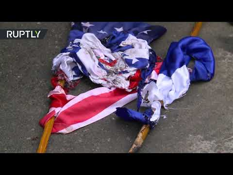 Burning US & Israeli flags | Iranian protesters decry 'cowardly assassination' of nuclear scientist