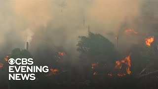 """Wildfires raging in the Amazon rainforest have set off a diplomatic firestorm ahead of the G-7 Summit in France this weekend. The rainforest has been burning at a rate of three football fields per minute. Elizabeth Palmer reports.  Subscribe to the """"CBS Evening News"""" Channel HERE: http://bit.ly/1S7Dhik Watch Full Episodes of the """"CBS Evening News"""" HERE: http://cbsn.ws/23XekKA Watch the latest installment of """"On the Road,"""" only on the """"CBS Evening News,"""" HERE: http://cbsn.ws/23XwqMH Follow """"CBS Evening News"""" on Instagram: http://bit.ly/1T8icTO Like """"CBS Evening News"""" on Facebook HERE: http://on.fb.me/1KxYobb Follow the """"CBS Evening News"""" on Twitter HERE: http://bit.ly/1O3dTTe Follow the """"CBS Evening News"""" on Google+ HERE: http://bit.ly/1Qs0aam  Get your news on the go! Download CBS News mobile apps HERE: http://cbsn.ws/1Xb1WC8  Get new episodes of shows you love across devices the next day, stream local news live, and watch full seasons of CBS fan favorites anytime, anywhere with CBS All Access. Try it free! http://bit.ly/1OQA29B  --- The """"CBS Evening News"""" premiered as a half-hour broadcast on Sept. 2, 1963. Check local listings for CBS Evening News broadcast times."""