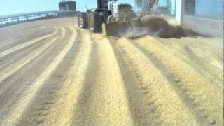 Dozing Corn at Ethanol Plant - 66/69/72 and 7900 Series Degelman Dozers