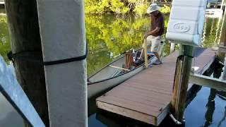 Gin pole to assist in boarding a canoe.