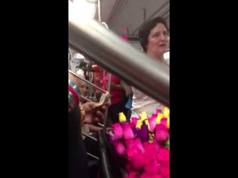 Man on subway makes flower lady's day by buying up all of her roses. Asks her to give them out to everyone.