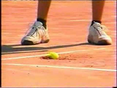 Andy Roddick serves a ball on clay and it gets stuck.