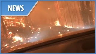 Father and son drive into a wildfire