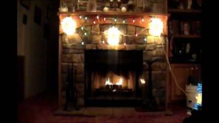 (3 songs) Mac Wiseman Christmas music set to my home made yule log presentation