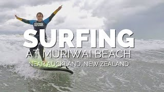 Surfing in Auckland at Muriwai Beach, NZ