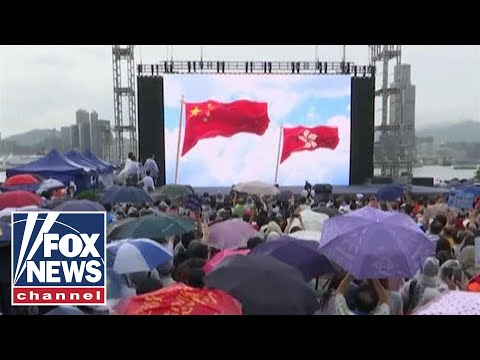 Pro-democracy, pro-government stage dueling protests in Hong Kong