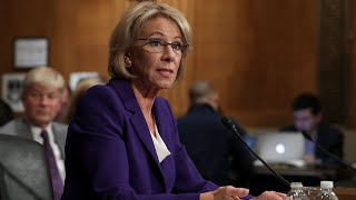 DeVos issues new interim rules on campus assault