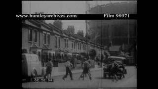 Boys play football in the street.  Archive film 98971