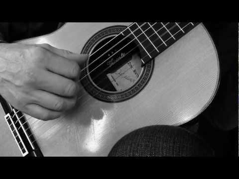 "Jens Felger,  guitar  plays ""Clouds in the river"""