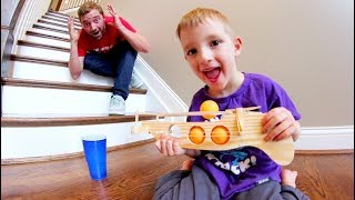 Father Son PING PONG GUN TRICK SHOTS!