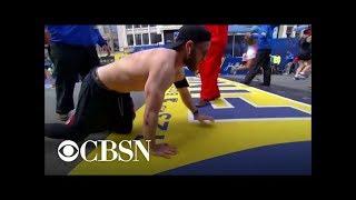 Marine vet crawls across Boston Marathon finish line