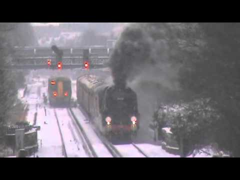 35028 'Clan Line' departs Redhill in heavy snow with the VSO…