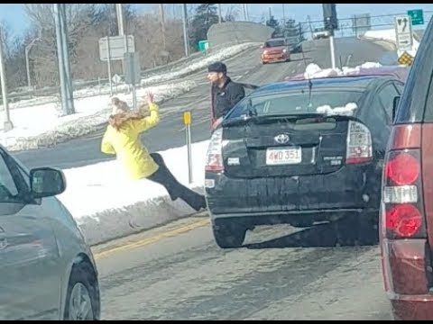 Man shoves woman in road rage incident caught on camera