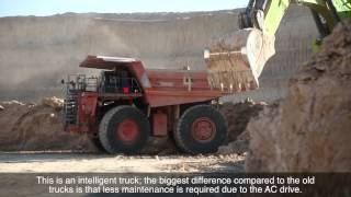 preview picture of video 'Hitachi dump trucks are driving force in Israel's Negev Desert mine'
