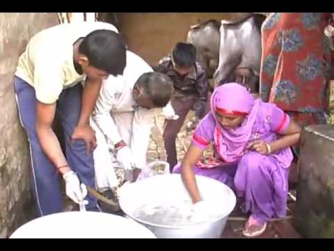 Mr. Ashok Kumar and his family working in their farm