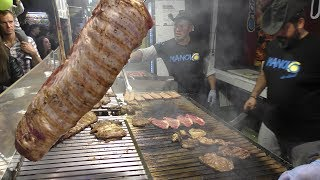 Huge Grill of Beef and Sausages from Argentina. Italy Street Food Festival