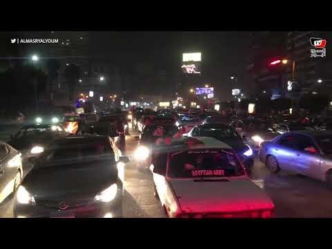 احتفالات جماهير الأهلى بشارع جامعة الدول والأمن يغلق الطريق أمام بوابات نادي الزمالك