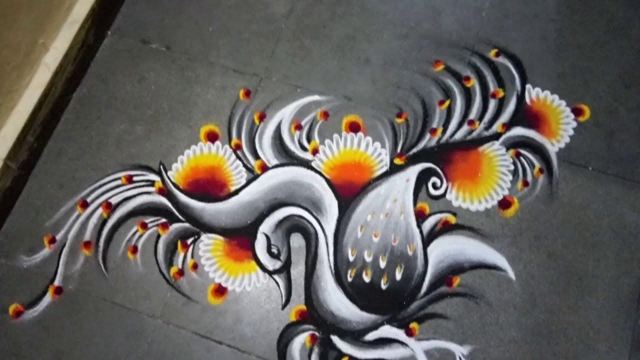 peacock rangoli design in black and white