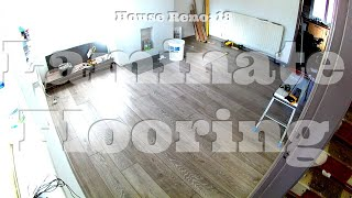 Laying Laminate Flooring In The Living Room And Hall Way