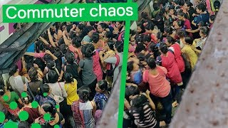 Indian Commuters Fight to Board Train at Rush Hour