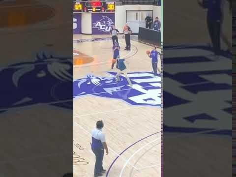 Basketball Player Attempting Long Pass Hits Spectators - 1083210