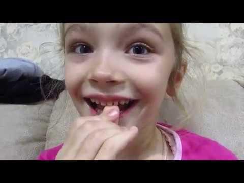 как вырвать молочный зуб дома без боли