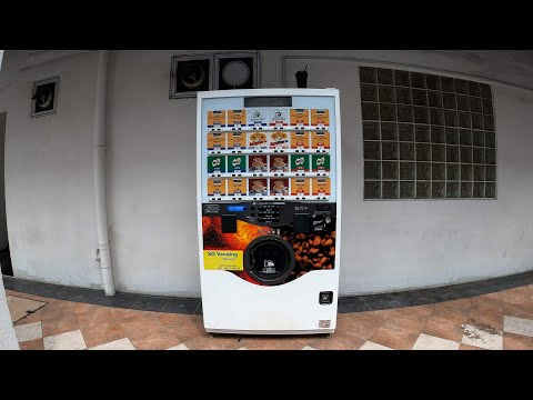 Dude Trying Out Vending Machines in Singapore