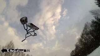 Первые попытки бекфлипа на дерте на сноускуте