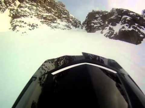 When You Go Up a Mountain on a Snowmobile and Chased Down by a Snowmobile