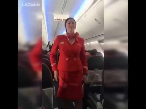 Passengers distract Air Hostess