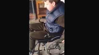 Boy falling out of wheelchair