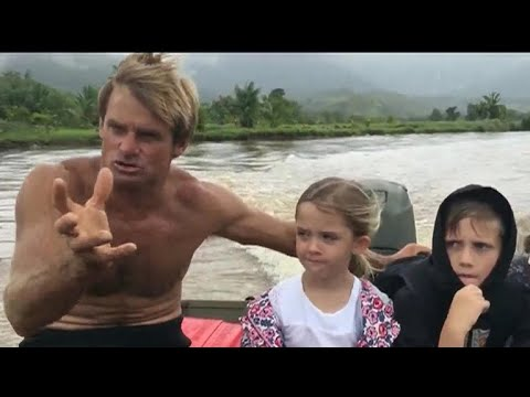 Pro surfer rescues family stranded by Hawaii storms
