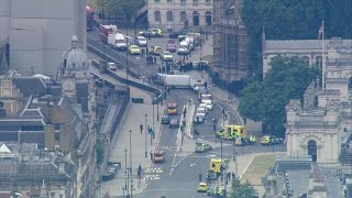 Car crashes outside British Parliament in suspected terrorist attack