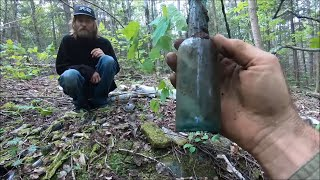 Digging And Collecting Bottles From An Old Mining Dump