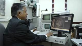 preview picture of video 'Aruna & Hari Sharma at  Electron Microscopy, Univ Basque Countries, Bilbao, Spain Dec 13, 2012.mov'