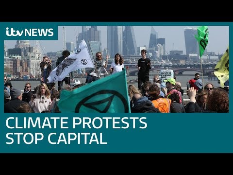 Climate change activists block parts of central London in environmental protest | ITV News