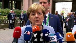 Belgium: Merkel, Macron and May in hushed exchange ahead of EU Council Brexit talks