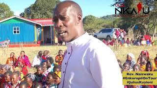 Ole Naiswaku preaching at Morijo Loita