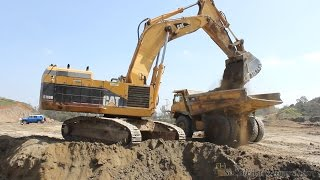 CAT 5110B excavator loading 773B 's