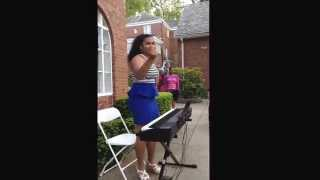 My niece We' singing a song for her sister's graduation. She wrote the lyrics. Talented.