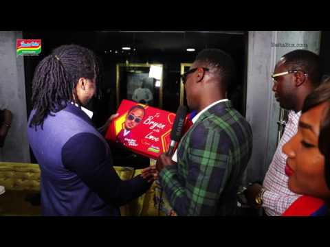 Bryan Okwara receives his Special Celebrity Pack from Indomie