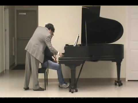 Individual lesson at the piano.  Young adult student.  Music of Chopin.