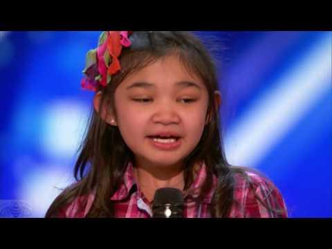 9 year old girl surprises singing