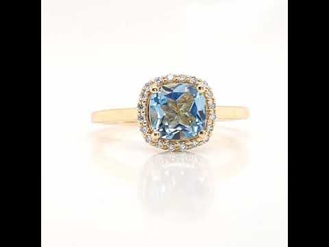 Anillo CyC Colección Berry con topacio azul y diamantes en oro amarillo 18k
