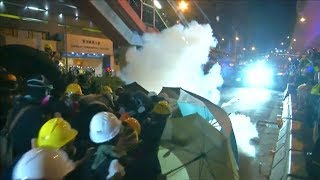 video: Hong Kong protesters block tunnel as marches continue in defiance of Beijing
