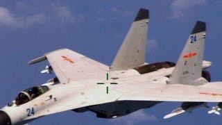 Chinese jet intercepts U.S. surveillance plane