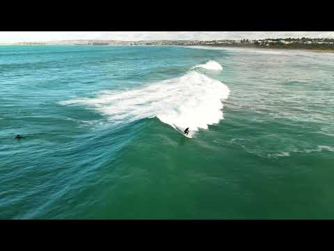 Aerial footage of Bullies surfing on fun day