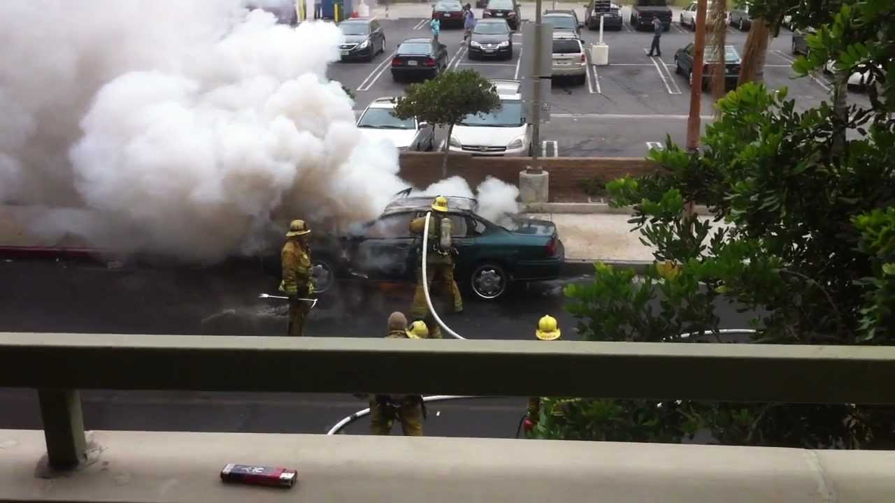 Burning Car Explodes Right On Firefighter's Face, Keeps Working