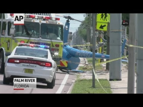 Authorities say a passenger in a truck was killed when a helicopter crashed on a busy Florida street. (April 4)