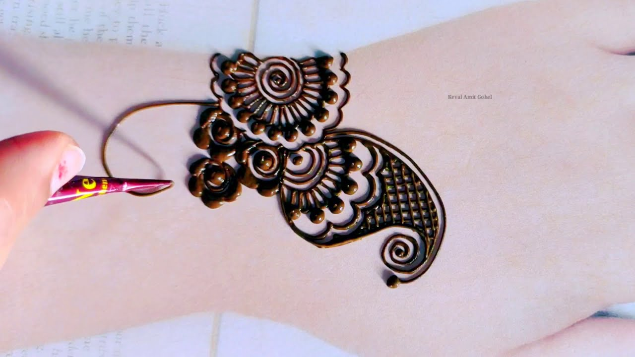 festival mehndi design for back hand by keval amit gohel